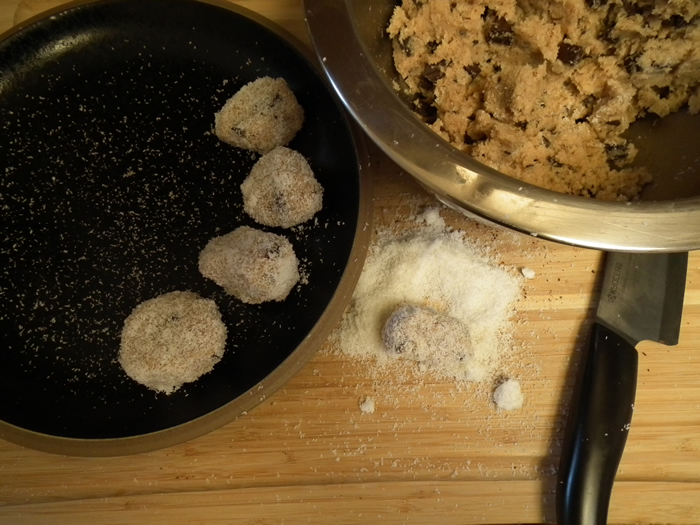 Rolling raw coconut macaroons...